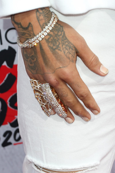 Chris Brown added serious bling to his red carpet ensemble with a pair of diamond tennis bracelets.