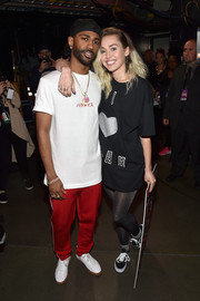 Black canvas sneakers rounded out Miley Cyrus' ensemble.