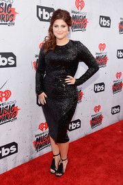 Meghan Trainor complemented her glamorous dress with fringed black sandals.