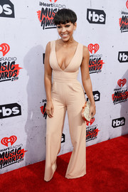 Meagan Good paired her sexy outfit with an elegant mother-of-pearl clutch.