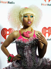 Nicki Minaj went all out at the iHeartRadio music festival wearing a gold and pink statement necklace.