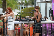 Aino Jawo sported a black tile dress for a cool mod look at the iHeartRadio pool party.