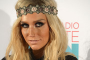 Ke$ha poses backstage at the iHeartRadio Ultimate Pool Party Presented by VISIT FLORIDA at Fontainebleau's BleauLive in Miami featuring live performances by Pitbull, Ke$ha, Afrojack, Icona Pop, Krewella and Jason Derulo on June 29, 2013 in Miami Beach, Florida.