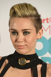 Miley kept her makeup to a minimum when she added a swipe of nude lipstick.