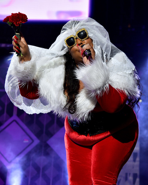 Lizzo performed during iHeartRadio's Z100 Jingle Ball 2019 wearing a pair of angular gold shades.
