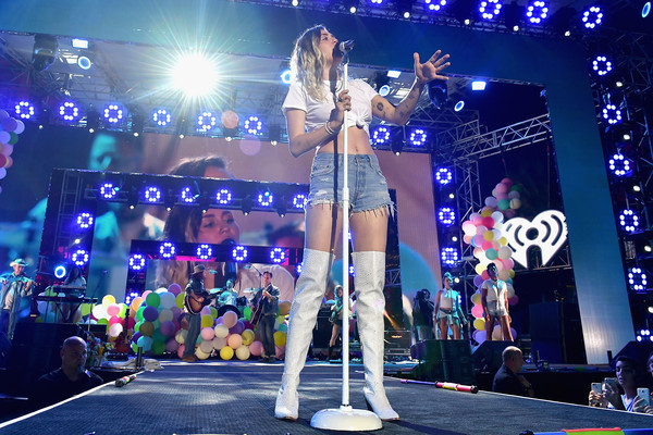 Miley Cyrus punched up her look with a pair of white thigh-high boots.