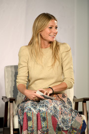 Gwyneth Paltrow looked simply stylish in a beige crewneck sweater and a printed skirt at the In goop Health Summit.