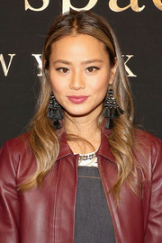 Jamie Chung wore her long tresses loose with soft waves and a center part at the Kate Spade fashion presentation.