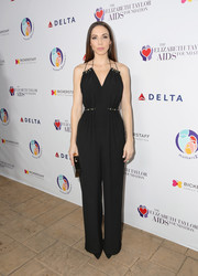 Whitney Cummings attended the mothers2mothers and Elizabeth Taylor AIDS Foundation benefit dinner wearing a black jumpsuit with a strappy neckline.