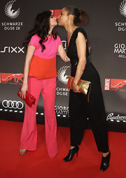 Shermine Shahrivar carried a red leather purse at the 2011 New Faces Awards.