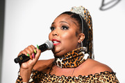 Lizzo accessorized with a leopard-print scarf to match her dress at the CURVYcon.