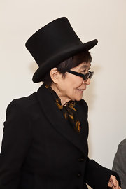 Yoko Ono indulged her quirky side by opting for a classic black top hat as she sat at the front row of threeASFOUR's show during Fashion Week.