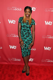Estelle showed off her wild side with this green, leopard-print dress with a cutout back detail.
