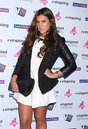 Garbriella Ellis chose a black blazer with leather sleeves for for her black and white look at the vInspired Awards.