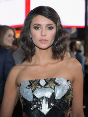 Nina Dobrev looked youthful and lovely wearing this wavy hairstyle, complete with a bejeweled barrette, at the LA premiere of 'xXx: Return of Xander Cage.'