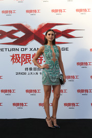 Nina Dobrev teamed her dress with a pair of iridescent pumps by Christian Louboutin.