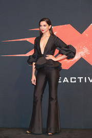 Deepika Padukone looked perfectly chic at the world premiere of 'xXx: Return of Xander Cage' in a black Johanna Ortiz top featuring a peplum waist, a plunging neckline, and sculptural sleeves.