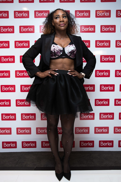 Serena Williams dressed up her toned legs in a pair of fishnet tights.