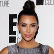 Kim Kardashian! She's been rocking a topknot forever, and it always looks fresh and fashionable.