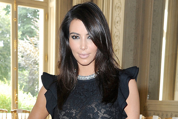 Look of the Day: Kim Kardashian's Little Black Dress and Gladiator Heels