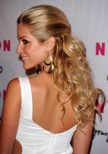 beauty with a classic half up hairstyle: Strands are straight up top,