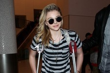 Chloe Grace Moretz Travels on Crutches