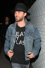 Jared Leto made wore his classic denim jacket with a black fedora.