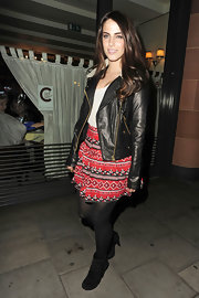 Jessica Lowndes teamed her ethnic print mini skirt with black suede ankle booties.