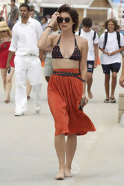 Jessica Stroup steps on the set of 90210 wearing a diamond print bikini with multi-straps. The chic starlet paired the look with a high-waisted flouncy skirt and wrap-around belt.
