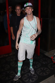 Aaron Carter showed off his unique style while out in Hollywood, when he sported a pale teal tank and matching socks.