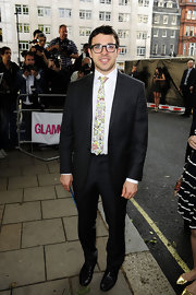 Simon Bird updated his timeless black suit with a quirky pastel floral tie.