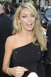 Abbey Clancy styled her hair with a deep side part for the Pride of Britain Awards.