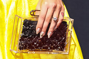 We love how Kelly added a cool punk touch to her sweet yellow frock by accessorizing with this clear safety-pin clutch.