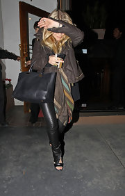 Ashley Olsen left Madeo restaurant in LA with a black leather tote draped over her elbow.