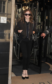 Chloe showed off her fashion chops with this brown and black bomber jacket.