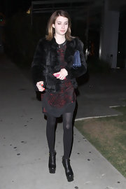 Emma added pep to her step with black ankle boots.