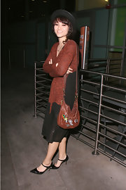 Fivel Stewart was seen at the 'Rogue' premiere in a boho ensemble styled with a leather swingpack.
