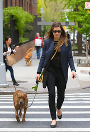 Jessica Biel rocked a dark navy wool coat while out walking her dog in NYC.