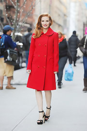Jessica Chastain looked mod in this rich winter red coat with a Peter Pan collar and circle pockets.