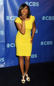 Taraji P. Henson delighted in bright white T-bar sandals, which showcased her lemon yellow pedicure.