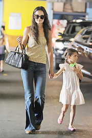 Katie Holmes kept her look casual-chic with this soft yellow camisole that featured black dotted designs.