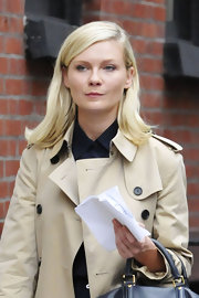 Sure, Kirsten Dunst may be on set, but her character's sleek, up-turned bob is adorable. To get a good flip, mist hair ends with a product like Bumble and Bumble Does It All Spray and bend ends up with a large-barreled curing iron. A good sweep with a brush and another mist of spray won't hurt.