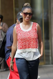 La La Anthony paired a red and white print blouse with silk pants for a stroll around New York City.