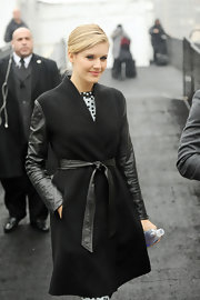 Maggie Grace mixed the girl next door and rocker chick with this leather and wool coat while attending an event at New York Fashion week.