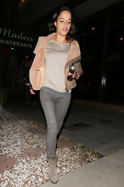 Michelle Rodriguez stayed true to her tomboy style with this brown bomber with fur lining.