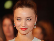 Miranda Kerr added a bold punch of color by sweeping on a vibrant orange lipstick.