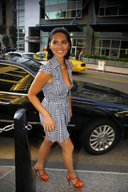 Olivia Munn brightened up her darling blue-and-white plaid shirtdress with a pair of orange platform sandals.