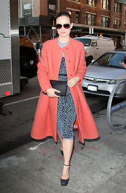 Olivia Wilde played up the feminine look with a classic blue dressed paired with a fitted pink wool coat.