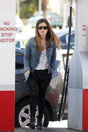 Those slouchy bow-adorned shorts injected a touch of youthful cuteness to Rachel Bilson's edgy look.