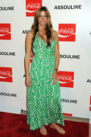 Kelly Bensimon kept her green printed maxi dress casual and summery with gold thong sandals.